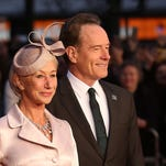 """Helen Mirren, left, and Bryan Cranston pose for photographers upon arrival at the premiere of the film """"Trumbo,"""" as part of the London film festival in London last month."""
