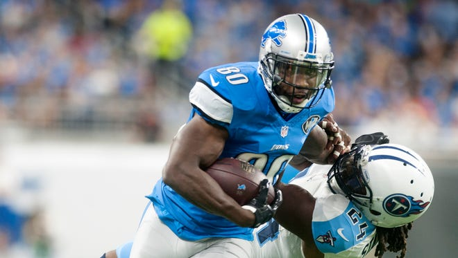Lions receiver Anquan Boldin stiff arms Titans safety Daimion Stafford during the home opener against Tennessee on Sunday, Sept. 18, 2016 at Ford Field in Detroit.