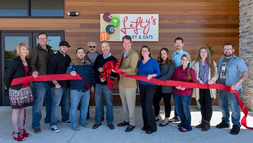 Members of Lefty's Alley & Eats gather for ribbon cutting.