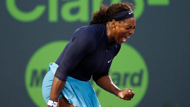 Serena Williams celebrates after winning match point against Christina McHale (not pictured) on day three of the Miami Open at Crandon Park Tennis Center on March 24.