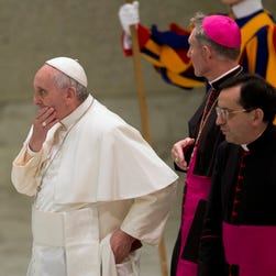 Pope Francis arrives in the Paul VI hall on Monday for an audience with the Holy See's employees at the Vatican.
