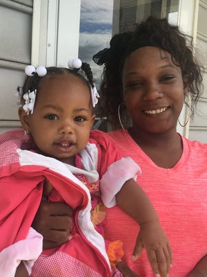 Tiesha Tims, pictured with her 16-month-old daughter, Ja'Liah Batchelor, could see her $100 a month rent at a west-side public housing complex rise to $150 a month under a new proposal from Housing Secretary Ben Carson aimed at getting more people to find work. Tims, who has four young children and works part-time as a home health aide, said it would be difficult to make ends meet with the increase.