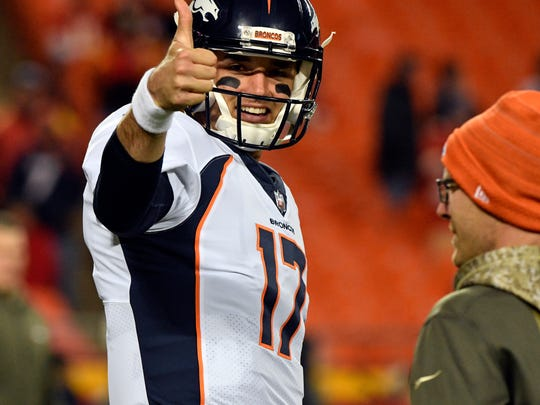 FILE - In this Oct. 30, 2017, file photo, Denver Broncos quarterback Brock Osweiler (17) gives a thumbs up before an NFL football game against the Kansas City Chiefs, in Kansas City, Mo. Two people familiar with the decision tell The Associated Press that Brock Osweiler has supplanted Trevor Siemian as the Denver Broncos' starting quarterback. Speaking on condition of anonymity because the team hasn't publicly announced the switch, both people confirmed coach Vance Joseph informed his players of the QB switch at a team meeting Wednesday morning, Nov. 1, 2017. (AP Photo/Ed Zurga, File)