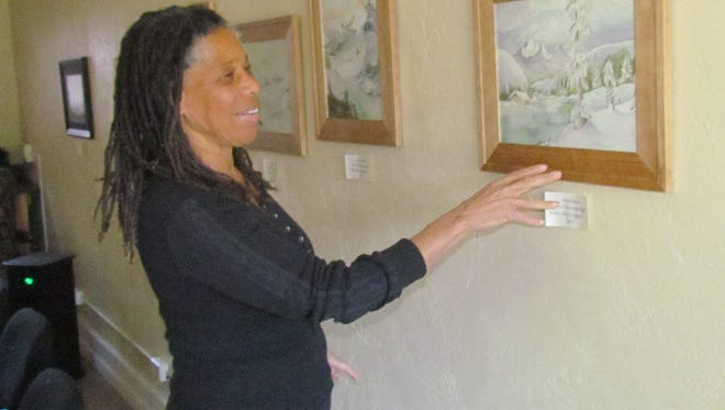 """Artists, writer and speaker Jean Moule of Lyons discusses her """"Cabins in the Snow"""" watercolors currently on display at Moxieberry in downtown Stayton."""