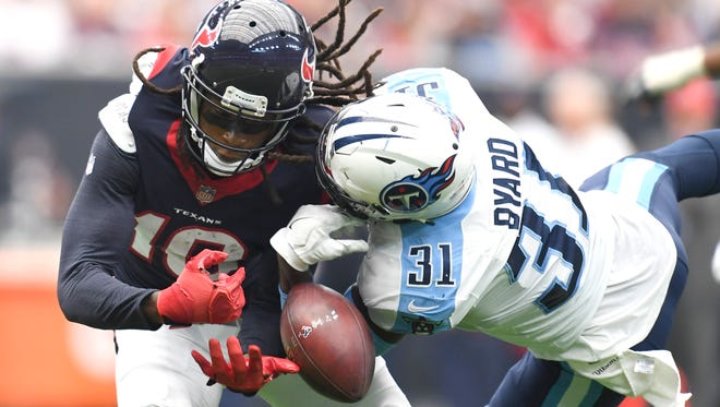Titans safety Kevin Byard (31) breaks up a pass for Texans wide receiver DeAndre Hopkins (10)  during the second quarter at NRG Stadium  Sunday, Oct. 1, 2017 in Houston, Texas.