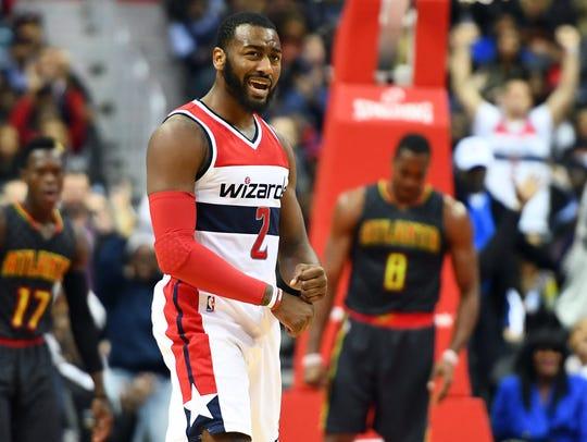 Washington Wizards guard John Wall reacts after a basket