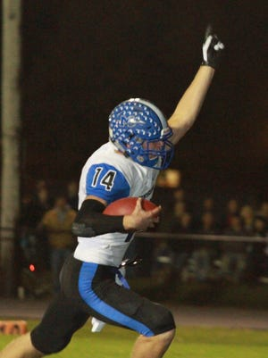 Montezuma's Logan Price, 14, celebrates after scoring during the Braves' 28-14 win over Lynnville-Sully on Friday, Oct, 21.