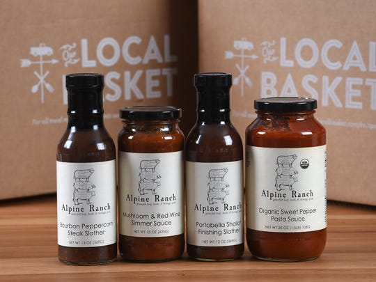 The add-on products for Our Local Basket meal delivery subscriptions include local Alpine Ranch sauces.