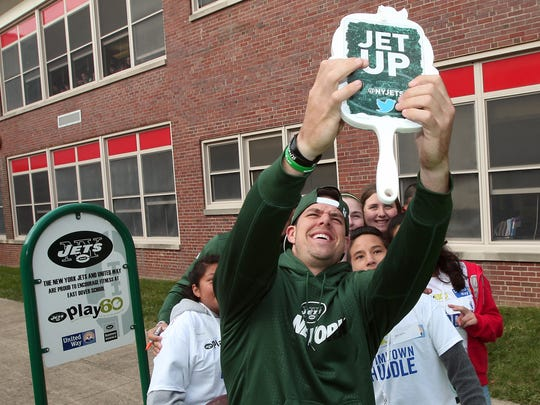 Ny Jets rookie quarterback Bryce Petty takes a selfie with students as members of the New York Jets unveil a PLAY 60 Fitness Zone playground with 35 students from Dover Middle School as part of the NFLÕs 17th annual Hometown Huddle, an NFL-wide day of service with United Ways across the nation. October 20, 2015, Dover, NJ