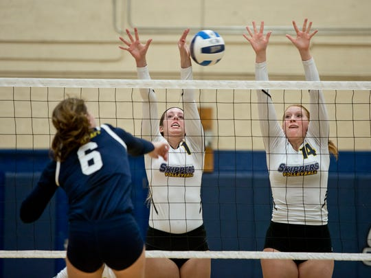 SC4's Tori Wangelin and Jordan Johnson jump to block a spike during a volleyball game Tuesday, October 21, 2015 at the St. Clair County Community College gymnasium.