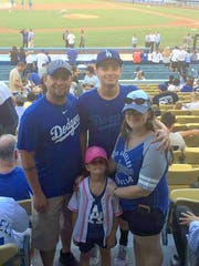 Lalo Rodriguez, left, and family at a recent trip to see the Dodgers play in Chavez-Ravine.