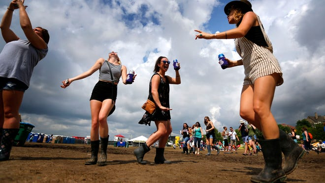 Festival-goers dance to the sounds of The Lone Bellow during the final day of the 2016 Memphis in May Beale Street Music Festival at Tom Lee Park. This year's festival will run from May 5-7.
