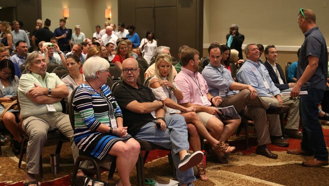 A crowded meeting room waits to hear a panel discuss residential real estate Saturday at the annual Community Conference of the Greater Tallahassee Chamber of Commerce held at the Omni Amelia Island Plantation.