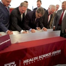 Gov. Rick Perry and top officials from Texas A&M University have dedicated a new 100,000-square-foot manufacturing plant that's to produce enough flu vaccine to treat 50 million people within four months of a declared pandemic.