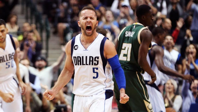 J.J. Barea (5) reacts after scoring in overtime against the Milwaukee Bucks at American Airlines Center.