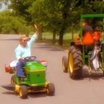 "Lengendary country singer George Jones spoofs his lawnmower exploits in a video for his hit ""Honky Tonk Song."""