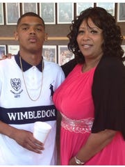 Michael J. Prescott and his mother, Pastor Rosslind Prescott-McClinton, pose for a photo after his high school graduation.