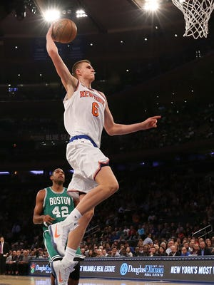 Kristaps Porzingis #6 of the New York Knicks goes up for a dunk against the Boston Celtics during the first half of their preseason game at Madison Square Garden on October 15, 2016 in New York City.