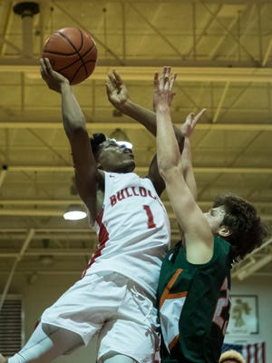 Bosse's Jaylin Chinn (1) makes a layup as Vincennes Lincoln's Isaac Lane (23) guards him at Bosse High School in Evansville, Ind., Saturday, Jan. 27, 2018. The Alices defeated the Bulldogs, 85-82.