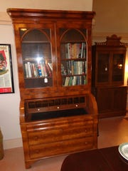 This handsome walnut secretary was crafted in about