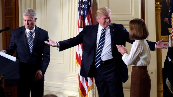 President Donald Trump gestures toward Louise Gorsuch after announcing 10th U.S. Circuit Court of Appeals Judge Neil Gorsuch as his choice for Supreme Court Justice during a televised address from the East Room of the White House in Washington, Tuesday, Jan. 31, 2017.