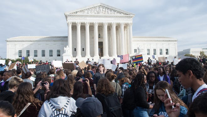 Secondary school students gather in front of the Supreme Court in November to protest Donald Trump's election.