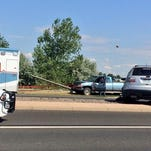 At least three vehicles, including the two seen here, were involved in a crash Friday afternoon on the outskirts of Fort Collins.