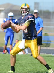 Ashwaubenon quarterback James Morgan throws a pass during a scrimmage against Wrightstown Friday.