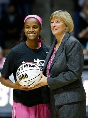 April Wilson is recognized by head coach Sharon Versyp as the newest member of the Purdue 1,000 point club before the Boilermakers game with Iowa Sunday, January 24, 2016, at Mackey Arena. Purdue defeated Iowa 90-73.