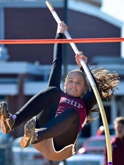Shippensburg's Natalie Nye competes in the pole vault during a meete against Greencastle-Antrim Tuesday at Kaley Field. Nye won with a school record 8-6 effort.