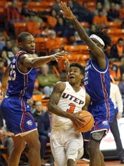 UTEP freshman guard Evan Gilyard, 3, drives through heavy traffic for a layup attempt against Oliver Powell, left, and Anthony Duruji, right, of Louisiana Tech Thursday night.