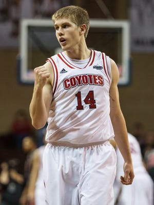 South Dakota Coyotes guard Casey Kasperbauer (14) celebrates during the first half against the UNLV Rebels.