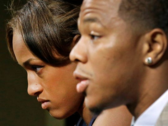Janay Rice sits by as her husband, then-Baltimore Ravens running back Ray Rice, speaks to the media during a news conference. In 2014, the football player knocked his then-fiancee unconscious in an Atlantic City elevator.