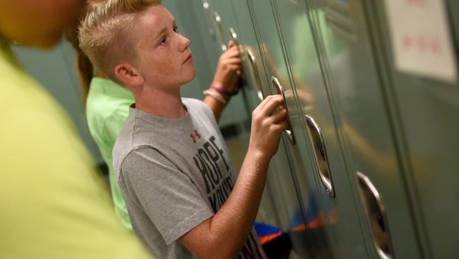Beau Giblin an incoming sixth grader practices opening lockers at Memorial Middle School during the Running Start program on Thursday, July 14, 2016.