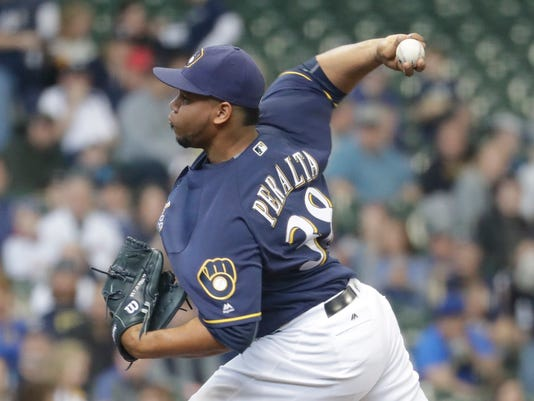 Milwaukee Brewers starting pitcher Wily Peralta throws during the first inning of a baseball game against the Miami Marlins Sunday, May 1, 2016, in Milwaukee. (AP Photo/Morry Gash)