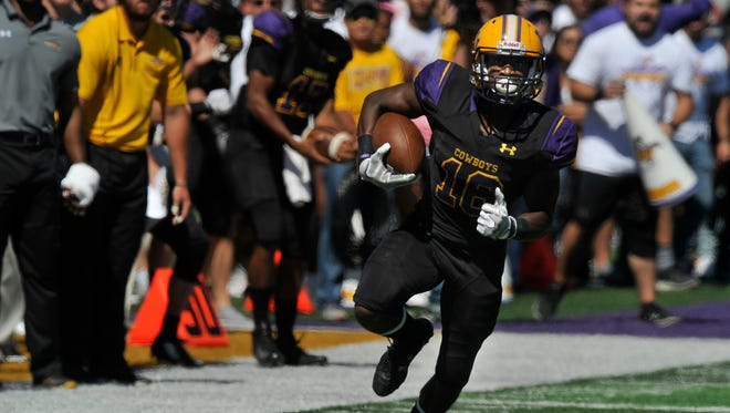 Cowboy running back Jaquan Hemphill sprints past the Hardin-Simmons University sideline as he carries the ball for HSU during Saturday's game against Mary Hardin-Baylor Oct. 7, 2017. Mary Hardin-Baylor won, 17-7.