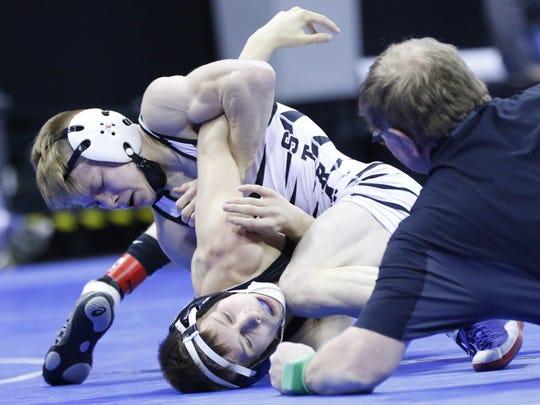 Stratford's Manny Drexler, top, wrestles to pin down