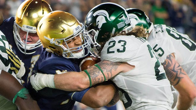 Notre Dame quarterback DeShone Kizer fights his way into the end zone as Michigan State Spartans linebacker Chris Frey (23) defends Saturday, Sept. 17, 2016 in South Bend.