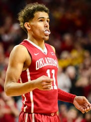 Oklahoma Sooners guard Trae Young (11) reacts during