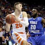 Syracuse's Tyler Lydon, left, looks to pass around Middle Tennessee's Giddy Potts during the second half of a second-round men's college basketball game in the NCAA Tournament, Sunday, March 20, 2016, in St. Louis. Syracuse won 75-50. (AP Photo/Jeff Roberson)