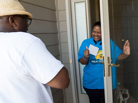 Marcus Vandiver, democratic candidate for Montgomery School Board District 1, talks with Sonja Patterson as he campaigns to win the runoff, June 19, 2018, in the Stoney Brook neighborhood in Montgomery, Ala.