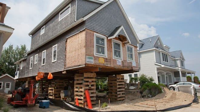 A Seaside Park home being elevated in 2013. Rebuilding is expected to get a boost on northern Ocean County's barrier island as a long-awaited beach replenishment project starts this summer.