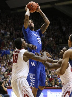 Jan 17, 2015; Tuscaloosa, AL, USA; Kentucky Wildcats forward Willie Cauley-Stein (15) shoots over Alabama Crimson Tide forward Jimmie Taylor (10) at Coleman Coliseum. Mandatory Credit: Marvin Gentry-USA TODAY Sports