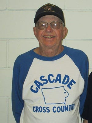 Bob Davidshofer of Cascade has won many honors. He's the Sunday Register girls' cross country coach of the year.