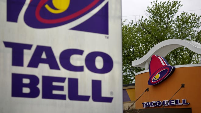 Taco Bell signage is displayed outside of a restaurant.