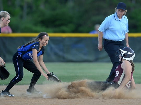 Mendon's Sara Lyons, right, slides safely into second,