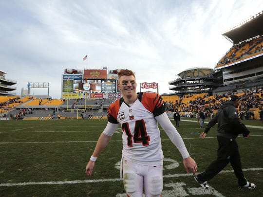Andy Dalton walks off the field after the Week 8 game against the Steelers.