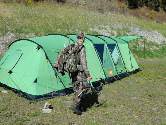 Chris White returns to camp with the final load of meat and his elk antlers.