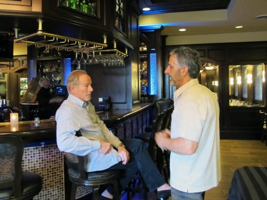 Bob Germain Jr., left, chats with Matt Berman on Nov. 29, 2016, at the newly opened St. Germain Steakhouse in Naples.