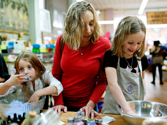 Tammy Barnaba, center, of Spring Grove, makes fizzies with her daughters Eilley, 5, left, and Maddie, 6, at Sunrise Soap Company during Go Green Day in York City, Saturday, April 22, 2017. Dawn J. Sagert photo